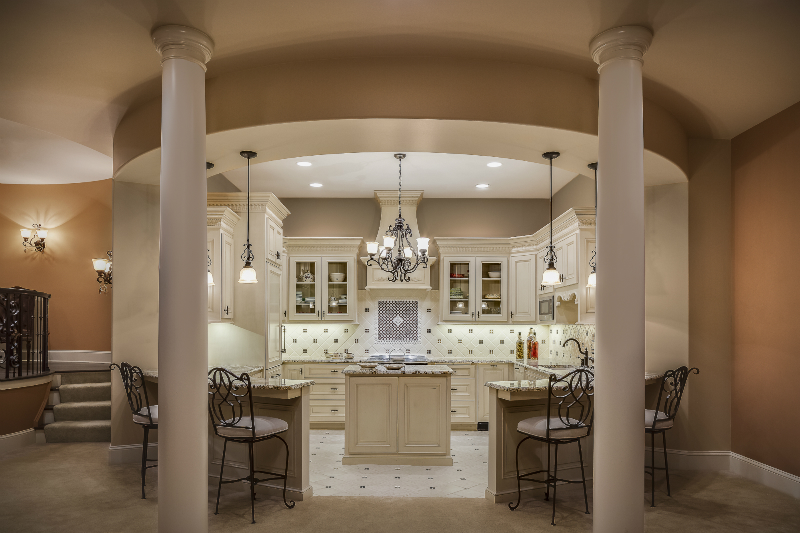 Tuscan-Style Lower Level Kitchen: A Design Connection, Inc. Featured on beautiful kitchen fireplace, electric kitchen fireplace, elevated living room, big kitchen fireplace,